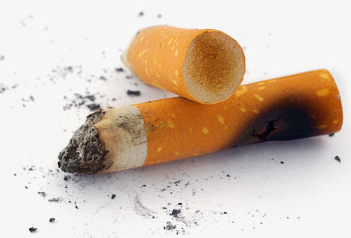 istock photo of stained cigarette butts - 16 روش سفید کردن دندان