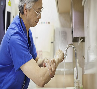 stock photo side view of male doctor washing hands 82889553.jpg.rendition.688.387 - مبانی کنترل عفونت دندانپزشکی